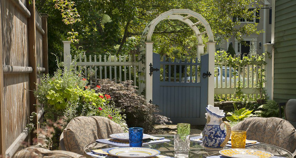 patio and container garden with arbor