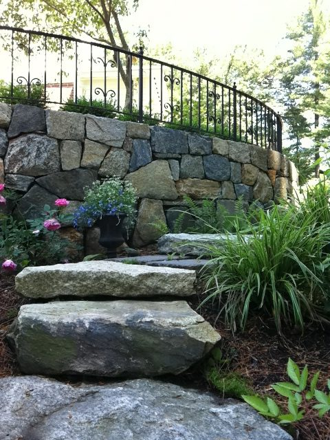 Retaining Wall with Decorative Wrought Iron Railing Top