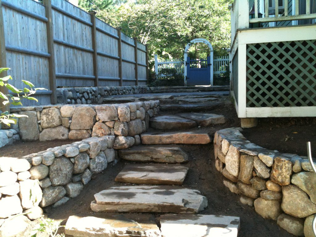 Large stone steps leading to patio seating area
